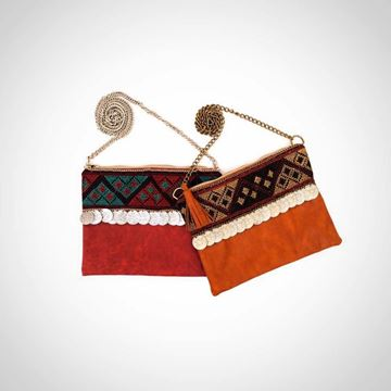 Picture of Cross body leather bag in red or in camel with pom coins