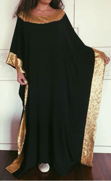 Picture of Black gown with gold paillettes