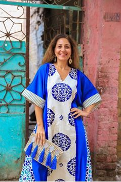 """Picture of Our linen """"Artistry"""" galabeya unleashes creativity! A perfect combination of Royal blue and shades of sea foam blues. Finish the look with our sand clutch embellished with kaffs and tassels."""