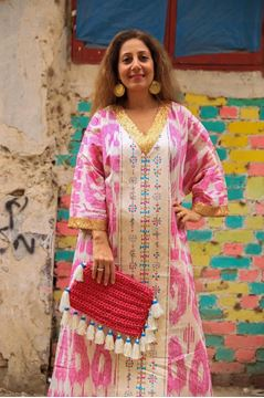 "Picture of Wanna dress to impress? Our ""Siwa"" galabeya promises to do just that!!! It's all about the perfect marriage of color and pattern. The look is perfect with our Fuchsia clutch"