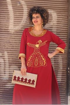 "Picture of Our handmade embroidered ""Dervishes"" burgundy galabeya is an awesome blend of fun and elegance!!! No more accessories needed other than our 'B U"" burgundy clutch embellished with golden sequins."