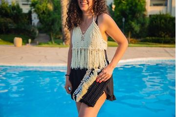 Picture of Backless cream top embellished with shells and tassels and flowy black shorts