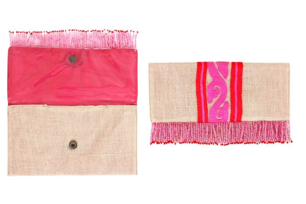 Picture of Lightweight linen clutches with vibrant colored details with red and pink. The beaded fringes add a popular touch of style