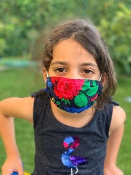 Picture of  Floral Mask with elastic bands for kids. -  Note: Color will vary depending on the material available.  - Our masks are composed of 4 layers including a filter and a nose support.