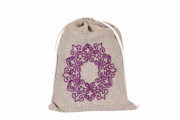 Picture of Mushreq embroidery in purple on a linen backpack L 52 * w 40
