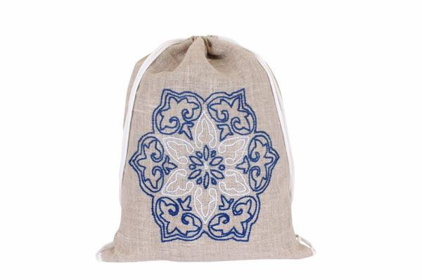Picture of Mushreq embroidery in blue on a linen backpack...L 52 * w 40