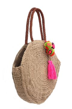 """Picture of """"Round and round we go again"""" crochet bag with leather handle. A pop of color is always a good idea with our handmade tassel and pompoms. L 39 * w 41"""