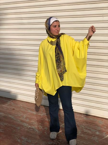 Picture of Plain long loose shirt in yellow.