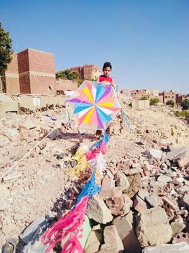 Picture of A colorful fan kite 1m width, with light and 4m and 130m rope .