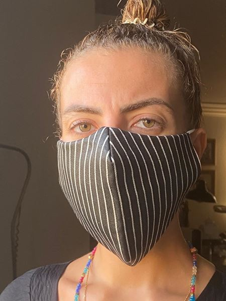 Picture of V-shaped mask with 2 layers fabric + a filter in the middle