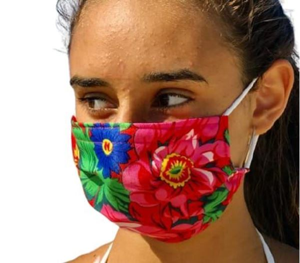 Picture of FLORAL MASKS WITH ELASTIC BANDS IN FUSHIA NOTE: COLORS WILL VARY DEPENDING ON THE MATERIAL AVAILABLE. - OUR MASKS ARE COMPOSED OF 3 LAYERS INCLUDING A FILTER AND A NOSE SUPPORT.