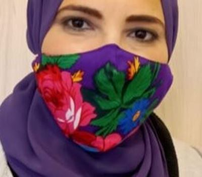 Picture of V-shaped floral mask in purple with 2 layers fabric + a filter in the middle